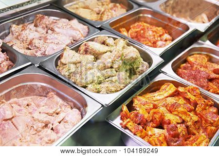 supermarket showcase or glass case of meat in souse