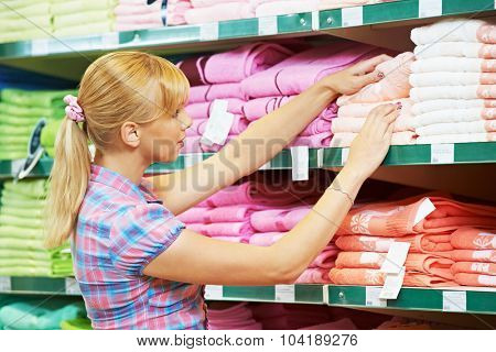 woman choosing bath towels textile in apparel clothes shop supermarket
