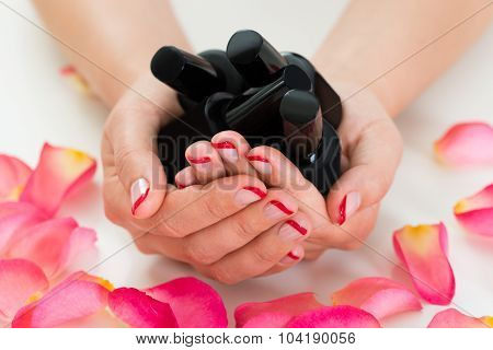 Woman Hands Holding Nail Varnish Bottles