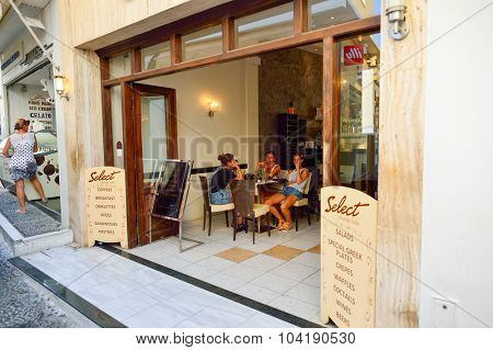 SANTORINI, GREECE - AUGUST 07, 2015: the restaurant entrance on Santorini island. The traditional architecture of Santorini is similar to that of the other Cyclades, with low-lying cubical houses