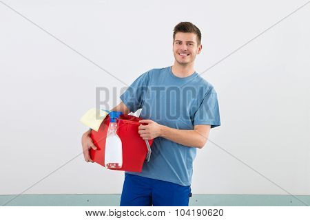 Male Janitor With Bucket And Dispenser Bottle