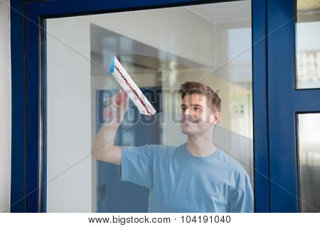 Worker Cleaning Glass With Mop
