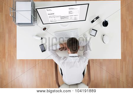 Businessman Sleeping In Front Of Computer At Desk