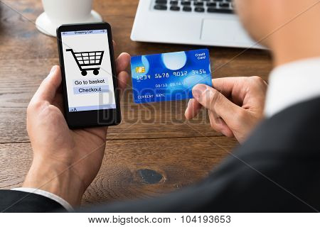 Businessperson With Credit Card And Mobile Phone