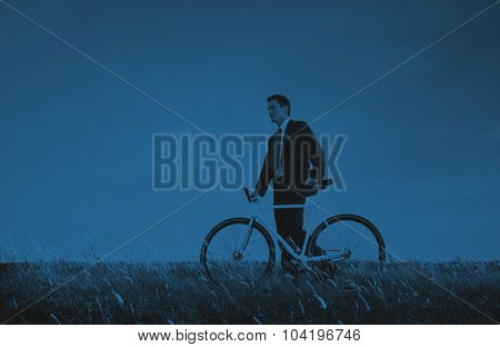Business Man Pushing Bike Outdoors Concept