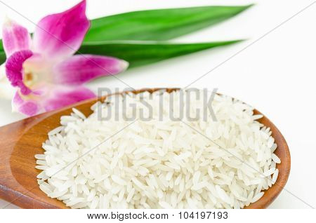 Raw Rice Jasmine In Wooden Spoon.