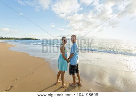 Couple in love walking along the beach together
