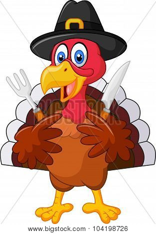 Thanksgiving turkey mascot holding knife and fork and wearing a pilgrim hat