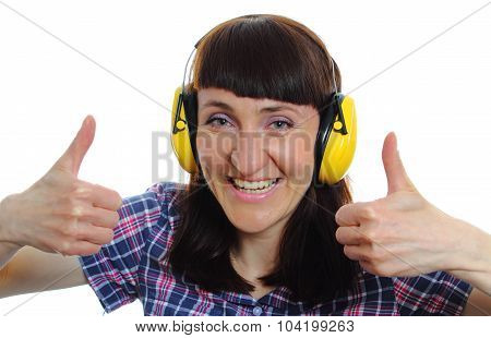 Woman Wearing Protective Headphones And Showing Thumbs Up