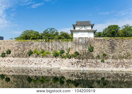 Reflection in the Moat with a Turret of Osaka Castle in Osaka, Japan