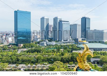 Golden fish of Roof tile with osaka business district, Kansai Japan