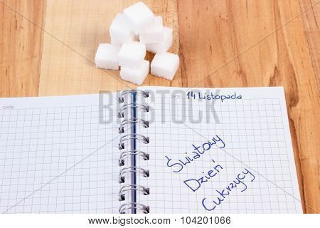 Polish Inscription World Diabetes Day In Notebook And Sugar Cubes, Symbol Of Diabetic