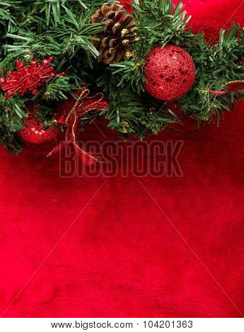 Decorated Christmas Fir Tree on red background.