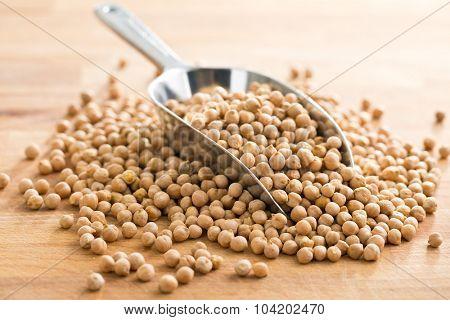 uncooked chickpeas in metal scoop