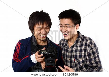 Two Asian Man Watching The Photo In Camera