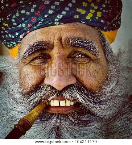 India Man Smoking Pipe Solitude Tranquil Wisdom Concept