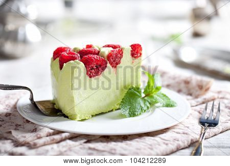 Pistachio mousse cake, cheesecake with raspberry