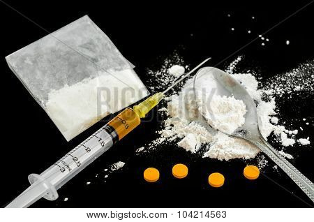Drug Syringe, Amphetamine Tablets And Cooked Heroin.