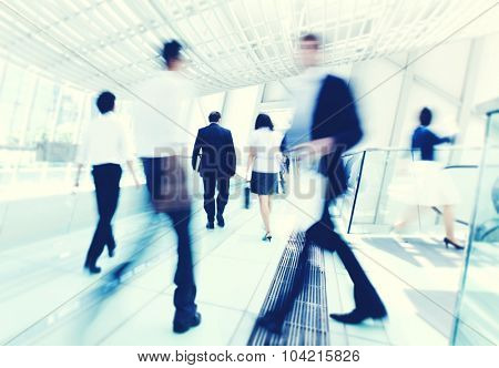 Business people in Asia. Hong Kong. Tilt shift lens with selective focus, Blurred motion. Blue tint.