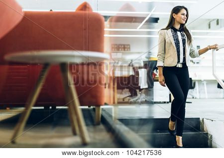 Beautiful Businesswoman Walking Down The Stairs