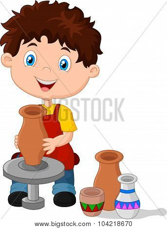 Happy little boy creating a vase on a pottery wheel