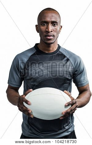 Portrait of sportsman standing with rugby ball against white background