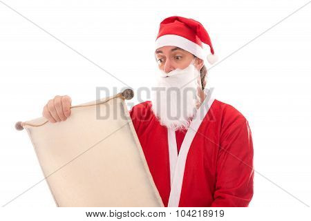 Santa Claus Reading In A Wish List Scroll, Isolated On White, Concept Traditionally Christmas