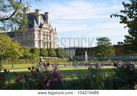 PARIS,  FRANCE - SEPTEMBER 8,  2014: Paris - Local and Tourist in famous Tuileries garden. Tuileries Garden (Jardin des Tuileries) is a public garden located between the Louvre Museum and the Place de la Concorde. France.