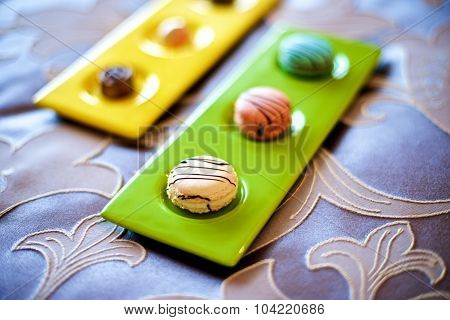 Colorful Macarons In Bed
