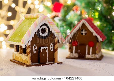 holidays, christmas, baking and sweets concept - closeup of beautiful gingerbread house on table