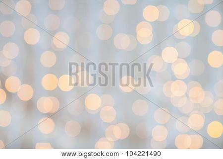 holidays, party and celebration concept - blurred golden lights background