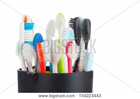 Group Of Old And Used Toothbrush In Plastic Cup