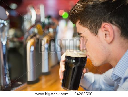 Close-up of man with drink at bar counter