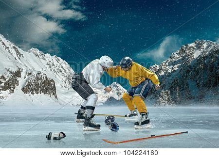 Ice hockey player in action outdoor around mountains
