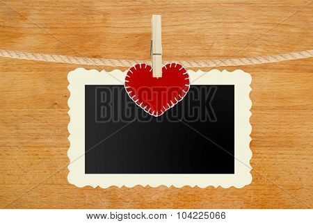 Photo Paper And Red Heart Hanging On Rope On Wooden Background