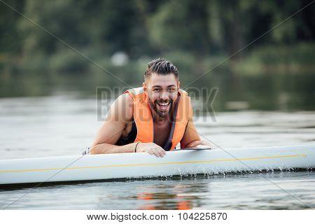 Handsome Wet Man On Paddleboard