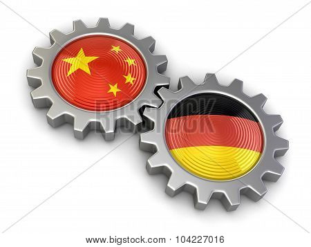 Chinese and German flags on a gears (clipping path included)