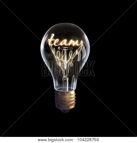 Glowing glass light bulb with word team inside