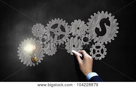 Conceptual image of gears and cogwheels drawn with chalk