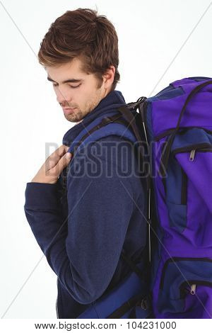 Side view of man with luggage against white background