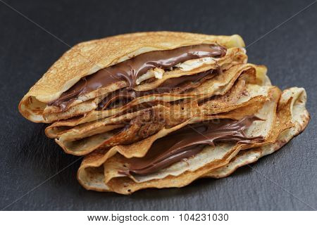 thin crepes or blinis with chocolate cream