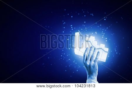 Close up of businessman hand presenting digital market graph