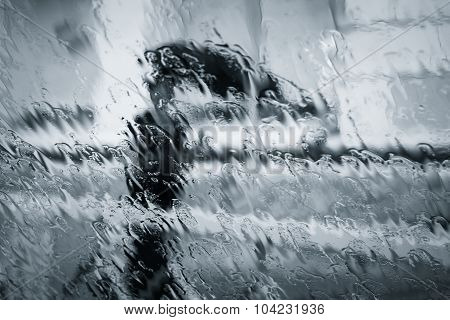 A Blurry Woman Silhouette Under The Rain
