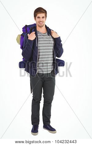 Portrait of happy man with backpack standing against white background