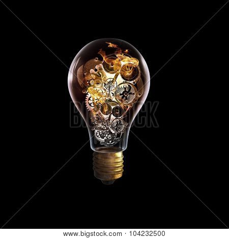 Light bulb concept with gears inside on dark background