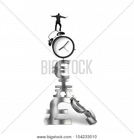 Businessman Balancing On Alarm Clock And Currency Symbols