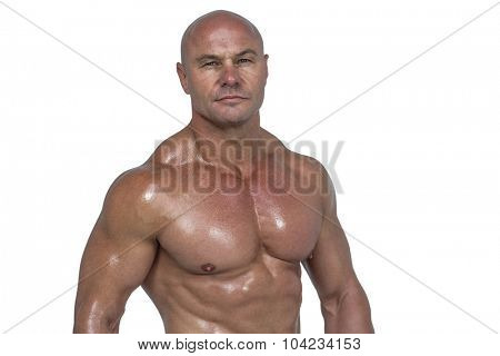 Portrait of muscular man against white background