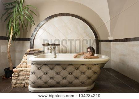 Smiling Beauty Girl In A Bathtub