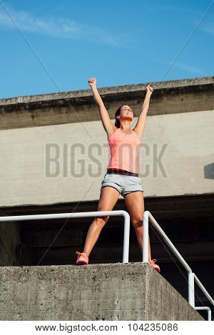 Woman Celebrating Sport And Fitness Success