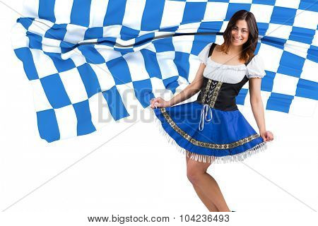 Pretty oktoberfest girl spreading skirt against blue and white flag